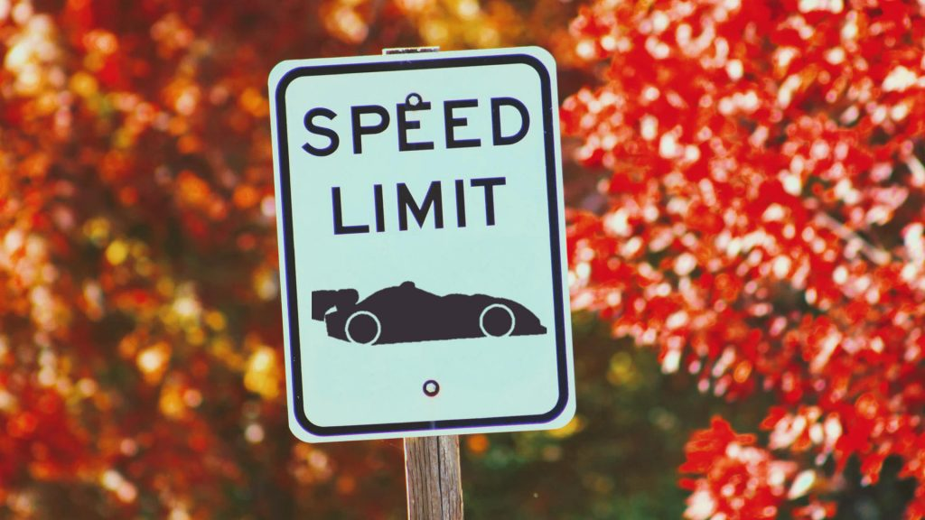 Speed limit sign with a race car icon instead of a number indicating the speed limit.